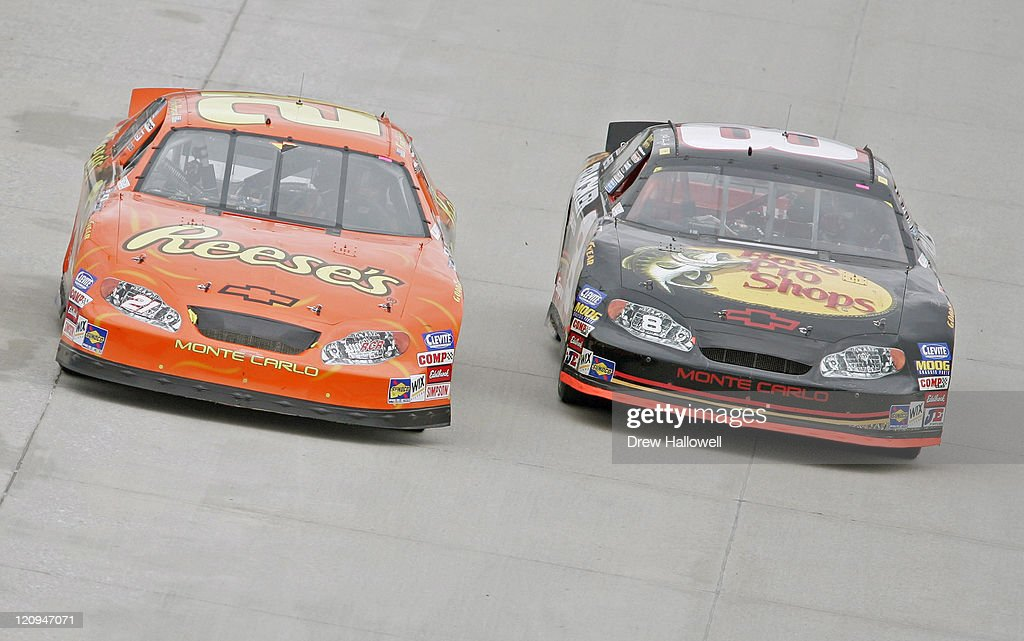 Kevin Harvick and Martin Truex Jr race side by side during the Nascar Busch Series MBNA RacePoints 200 June 4 at the Dover International Speedway in...