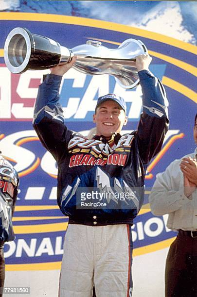 Kevin Harvick celebrates with his 2001 NASCAR Busch Series championship trophy
