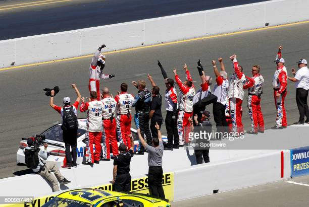 Kevin Harvick celebrates with his crew after winning the NASCAR Monster Energy Cup Series Toyota/Save Mart 350 on June 25 2017 at Sonoma Raceway in...