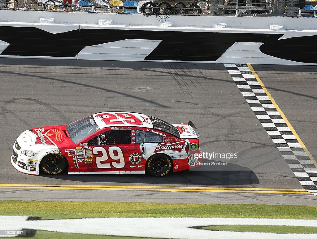 Kevin Harvick crosses the finish line to win the Budweiser Duel #1 at Daytona International Speedway in Daytona Beach, Florida, Thursday, February 21, 2013.