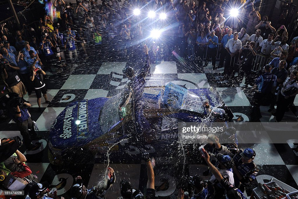 <a gi-track='captionPersonalityLinkClicked' href=/galleries/search?phrase=Kevin+Harvick&family=editorial&specificpeople=209186 ng-click='$event.stopPropagation()'>Kevin Harvick</a>, driver of the #33 Armour Chevrolet, celebrates in victory lane after winning the NASCAR Nationwide Series Virginia 529 College Savings 250 at Richmond International Raceway on September 7, 2012 in Richmond, Virginia.