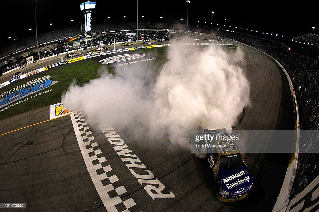 Kevin Harvick, driver of the #33 Armour Chevrolet, celebrates with a burn out after winning the NASCAR Nationwide Series Virginia 529 College Savings 250 at Richmond International Raceway on September 7, 2012 in Richmond, Virginia.
