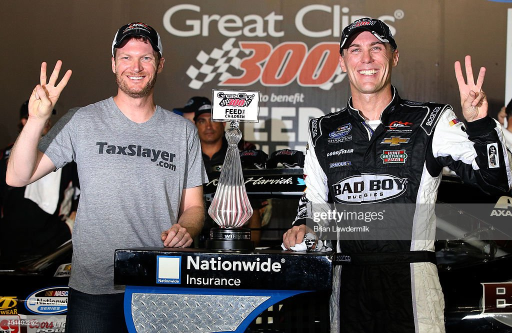 <a gi-track='captionPersonalityLinkClicked' href=/galleries/search?phrase=Kevin+Harvick&family=editorial&specificpeople=209186 ng-click='$event.stopPropagation()'>Kevin Harvick</a>, driver of the #5 Bad Boy Buggies Chevrolet, and <a gi-track='captionPersonalityLinkClicked' href=/galleries/search?phrase=Dale+Earnhardt+Jr.&family=editorial&specificpeople=171293 ng-click='$event.stopPropagation()'>Dale Earnhardt Jr.</a>, owner of Jr. Motorsports, pose with the trophy in Victory Lane after winning the NASCAR Nationwide Series Great Clips 300 at Atlanta Motor Speedway on August 30, 2014 in Hampton, Georgia.