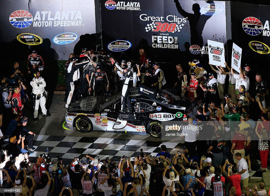 <a gi-track='captionPersonalityLinkClicked' href=/galleries/search?phrase=Kevin+Harvick&family=editorial&specificpeople=209186 ng-click='$event.stopPropagation()'>Kevin Harvick</a>, driver of the #5 Bad Boy Buggies Chevrolet, celebrates in Victory Lane after winning the NASCAR Nationwide Series Great Clips 300 at Atlanta Motor Speedway on August 30, 2014 in Hampton, Georgia.