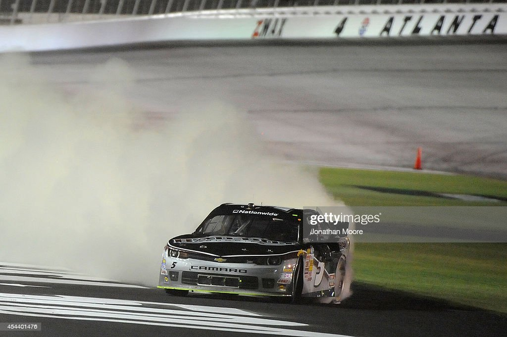 <a gi-track='captionPersonalityLinkClicked' href=/galleries/search?phrase=Kevin+Harvick&family=editorial&specificpeople=209186 ng-click='$event.stopPropagation()'>Kevin Harvick</a>, driver of the #5 Bad Boy Buggies Chevrolet, celebrates with a burnout after winning the NASCAR Nationwide Series Great Clips 300 at Atlanta Motor Speedway on August 30, 2014 in Hampton, Georgia.