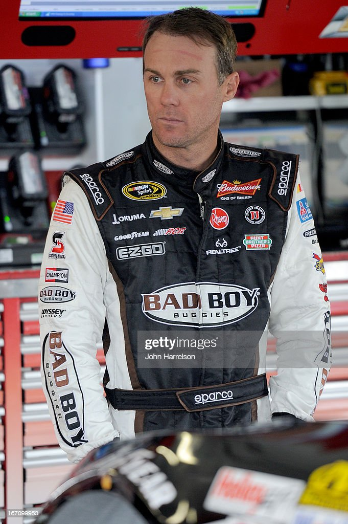 Kevin Harvick, driver of the #29 Bad Boy Buggies Chevrolet, stands in the garage during practice for the NASCAR Sprint Cup Series STP 400 at Kansas Speedway on April 20, 2013 in Kansas City, Kansas.