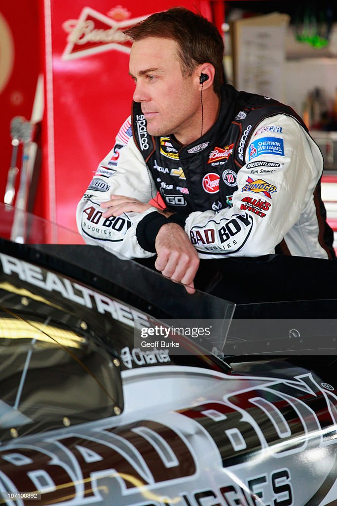 Kevin Harvick, driver of the #29 Bad Boy Buggies Chevrolet, stands in the garage prior to practice for the NASCAR Sprint Cup Series STP 400 at Kansas Speedway on April 20, 2013 in Kansas City, Kansas.