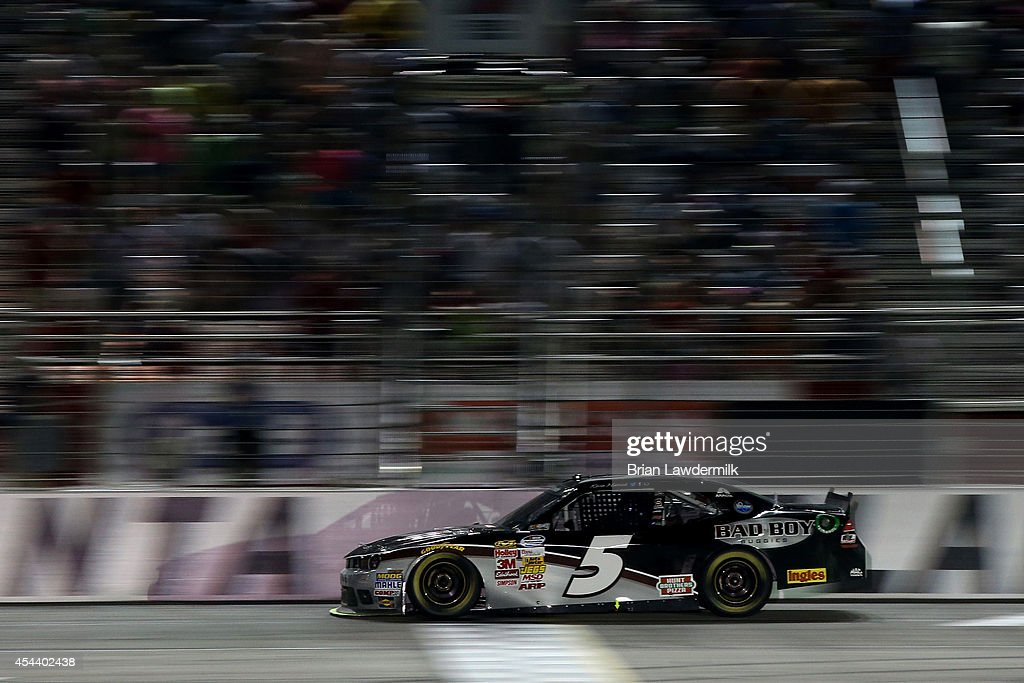 <a gi-track='captionPersonalityLinkClicked' href=/galleries/search?phrase=Kevin+Harvick&family=editorial&specificpeople=209186 ng-click='$event.stopPropagation()'>Kevin Harvick</a>, driver of the #5 Bad Boy Buggies Chevrolet, takes the checkered flag to win the NASCAR Nationwide Series Great Clips 300 at Atlanta Motor Speedway on August 30, 2014 in Hampton, Georgia.