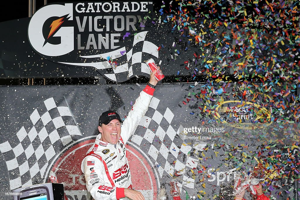<a gi-track='captionPersonalityLinkClicked' href=/galleries/search?phrase=Kevin+Harvick&family=editorial&specificpeople=209186 ng-click='$event.stopPropagation()'>Kevin Harvick</a>, driver of the #29 Bell Helicopter Chevrolet, celebrates in Victory Lane after winning the NASCAR Sprint Cup Series Toyota Owners 400 at Richmond International Raceway on April 27, 2013 in Richmond, Virginia.