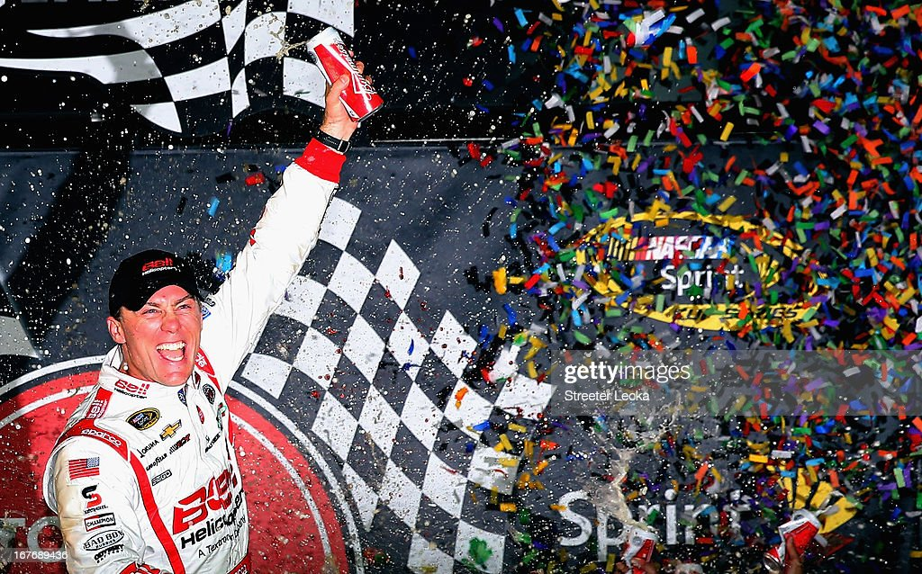 Kevin Harvick, driver of the #29 Bell Helicopter Chevrolet, celebrates in Victory Lane after winning the NASCAR Sprint Cup Series Toyota Owners 400 at Richmond International Raceway on April 27, 2013 in Richmond, Virginia.