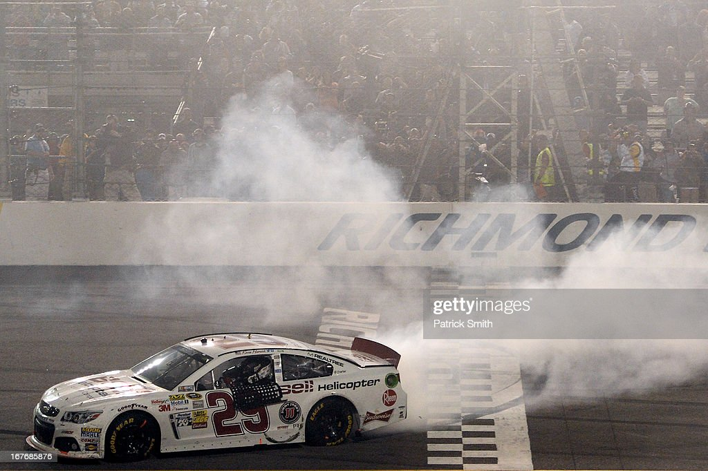 Kevin Harvick, driver of the #29 Bell Helicopter Chevrolet, celebrates with a burnout after winning the NASCAR Sprint Cup Series Toyota Owners 400 at Richmond International Raceway on April 27, 2013 in Richmond, Virginia.