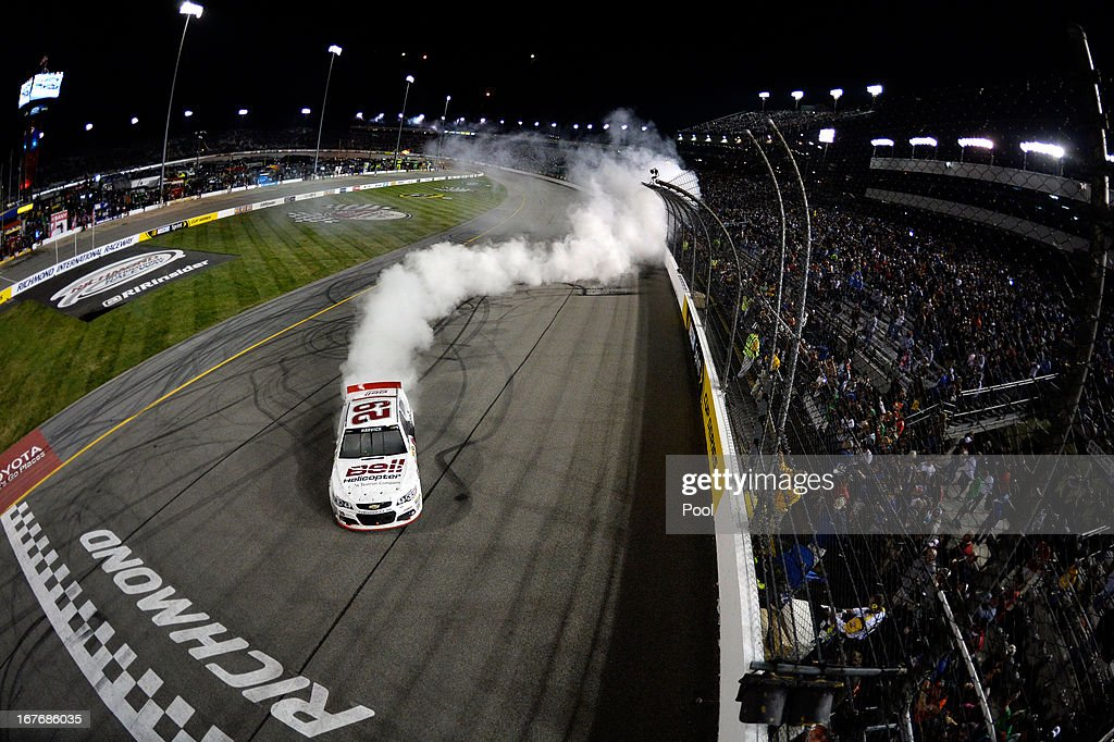 <a gi-track='captionPersonalityLinkClicked' href=/galleries/search?phrase=Kevin+Harvick&family=editorial&specificpeople=209186 ng-click='$event.stopPropagation()'>Kevin Harvick</a>, driver of the #29 Bell Helicopter Chevrolet, celebrates with a burnout after winning the NASCAR Sprint Cup Series Toyota Owners 400 at Richmond International Raceway on April 27, 2013 in Richmond, Virginia.