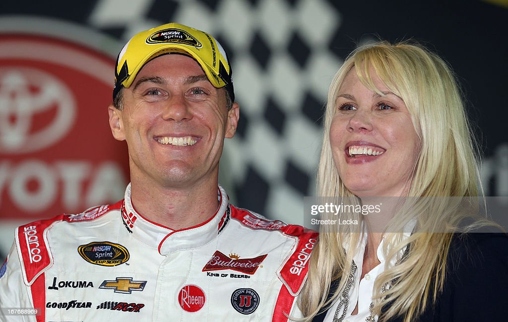 Kevin Harvick, driver of the #29 Bell Helicopter Chevrolet, celebrates with wife DeLana Harvick in Victory Lane after winning the NASCAR Sprint Cup Series Toyota Owners 400 at Richmond International Raceway on April 27, 2013 in Richmond, Virginia.