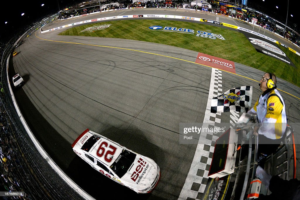 <a gi-track='captionPersonalityLinkClicked' href=/galleries/search?phrase=Kevin+Harvick&family=editorial&specificpeople=209186 ng-click='$event.stopPropagation()'>Kevin Harvick</a>, driver of the #29 Bell Helicopter Chevrolet, crosses the finish line to win the NASCAR Sprint Cup Series Toyota Owners 400 at Richmond International Raceway on April 27, 2013 in Richmond, Virginia.
