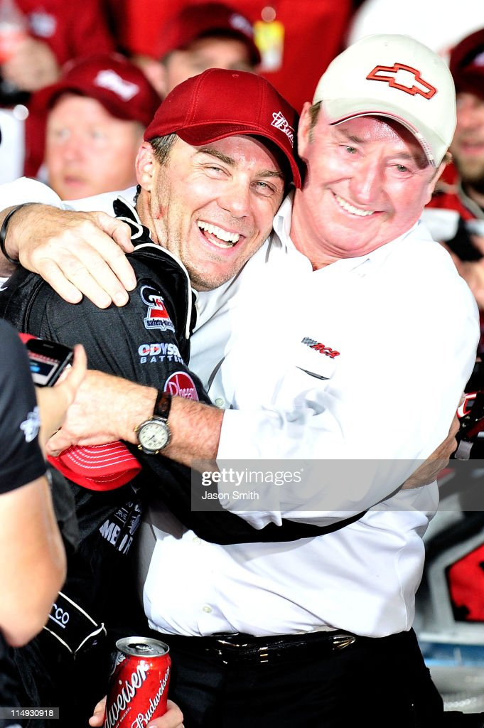 Kevin Harvick driver of the Budweiser Armed Forces Tribute Chevrolet hugs team owner Richard Childress in Victory Lane after winning the NASCAR...
