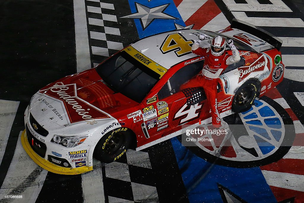 <a gi-track='captionPersonalityLinkClicked' href=/galleries/search?phrase=Kevin+Harvick&family=editorial&specificpeople=209186 ng-click='$event.stopPropagation()'>Kevin Harvick</a>, driver of the #4 Budweiser Chevrolet, celebrates after winning the NASCAR Sprint Cup Series Bank of America 500 at Charlotte Motor Speedway on October 11, 2014 in Charlotte, North Carolina.