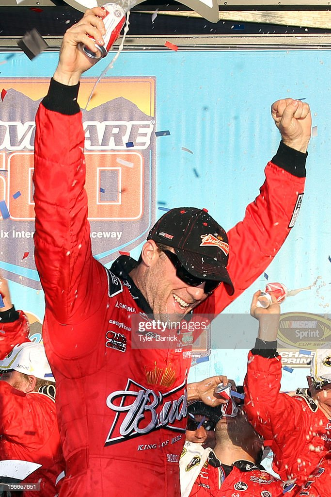 <a gi-track='captionPersonalityLinkClicked' href=/galleries/search?phrase=Kevin+Harvick&family=editorial&specificpeople=209186 ng-click='$event.stopPropagation()'>Kevin Harvick</a>, driver of the #29 Budweiser Chevrolet, celebrates in Victory Lane after winning the NASCAR Sprint Cup Series AdvoCare 500 at Phoenix International Raceway on November 11, 2012 in Avondale, Arizona.