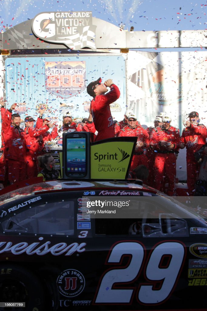 Kevin Harvick, driver of the #29 Budweiser Chevrolet, celebrates in Victory Lane after winning the NASCAR Sprint Cup Series AdvoCare 500 at Phoenix International Raceway on November 11, 2012 in Avondale, Arizona.