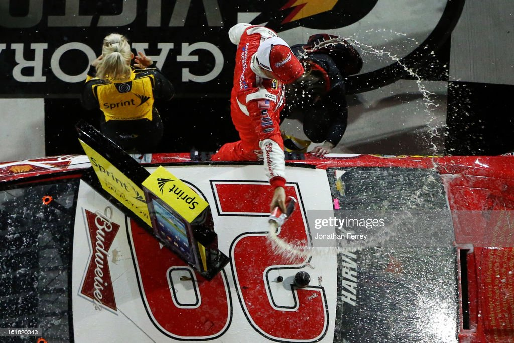 <a gi-track='captionPersonalityLinkClicked' href=/galleries/search?phrase=Kevin+Harvick&family=editorial&specificpeople=209186 ng-click='$event.stopPropagation()'>Kevin Harvick</a>, driver of the #29 Budweiser Chevrolet, celebrates in victory lane after winning the NASCAR Sprint Cup Series Sprint Unlimited at Daytona International Speedway on February 16, 2013 in Daytona Beach, Florida.