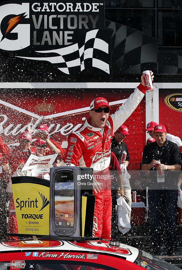 <a gi-track='captionPersonalityLinkClicked' href=/galleries/search?phrase=Kevin+Harvick&family=editorial&specificpeople=209186 ng-click='$event.stopPropagation()'>Kevin Harvick</a>, driver of the #29 Budweiser Chevrolet, celebrates in Victory Lane after winning the NASCAR Sprint Cup Series Budweiser Duel 1 at Daytona International Speedway on February 21, 2013 in Daytona Beach, Florida.