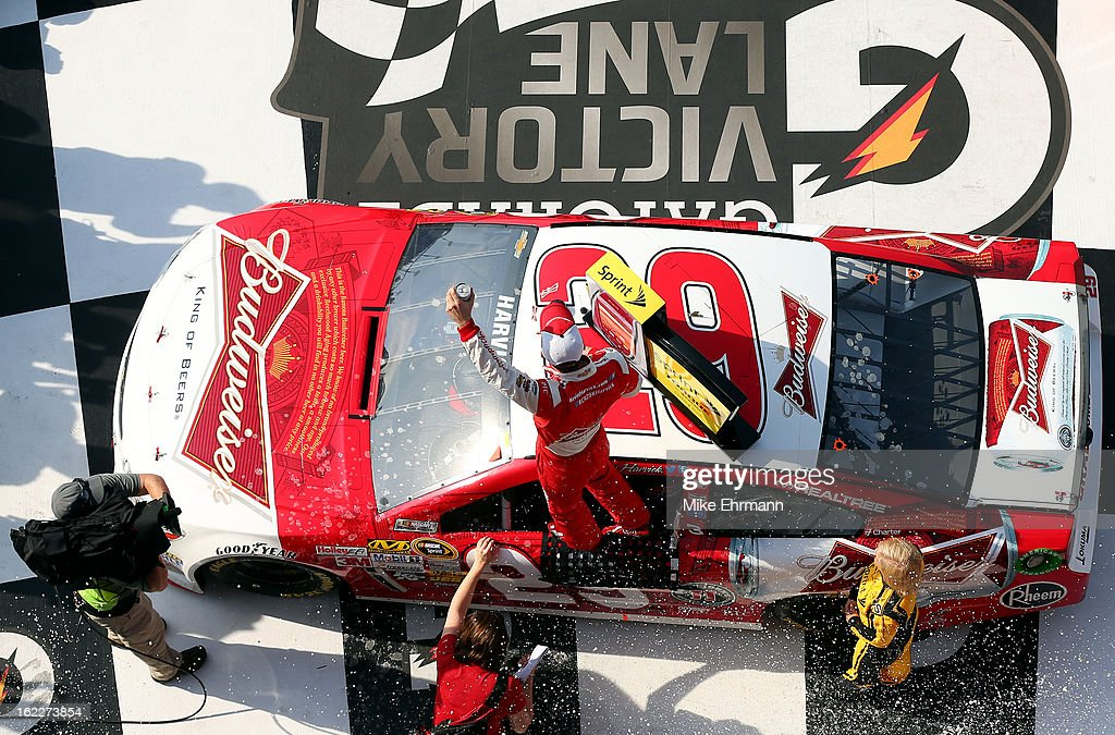 Kevin Harvick, driver of the #29 Budweiser Chevrolet, celebrates in Victory Lane after winning the NASCAR Sprint Cup Series Budweiser Duel 1 at Daytona International Speedway on February 21, 2013 in Daytona Beach, Florida.