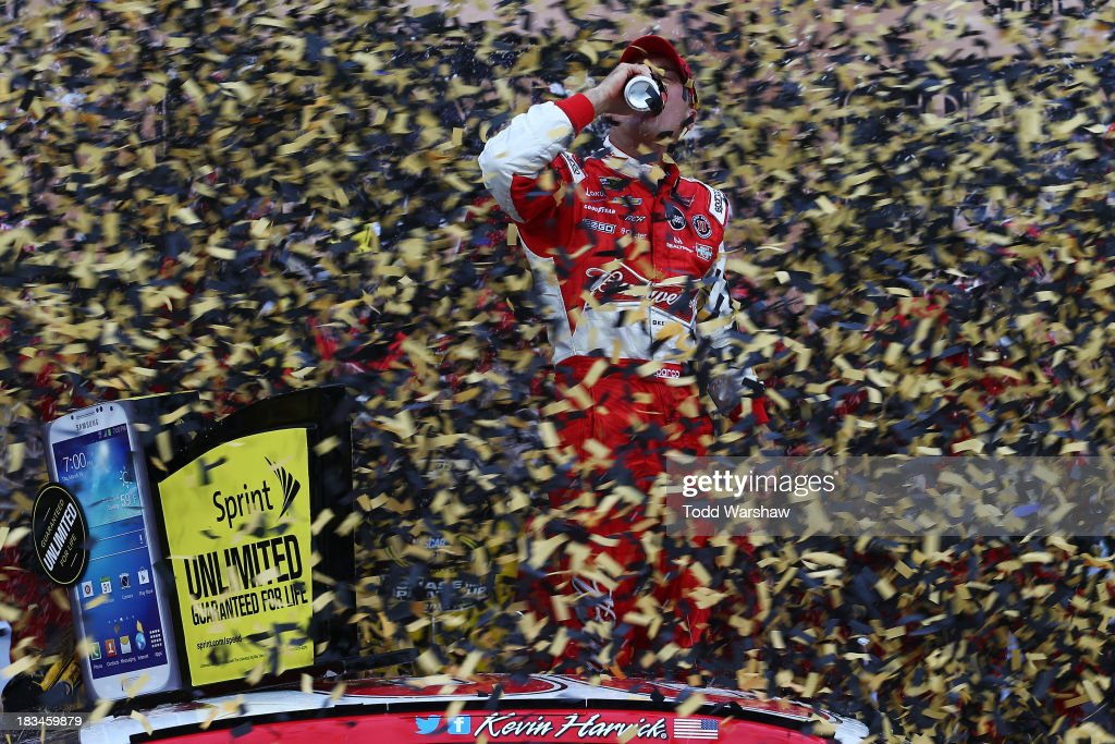 Kevin Harvick, driver of the #29 Budweiser Chevrolet, celebrates in Victory Lane after winning the NASCAR Sprint Cup Series 13th Annual Hollywood Casino 400 at Kansas Speedway on October 6, 2013 in Kansas City, Kansas.