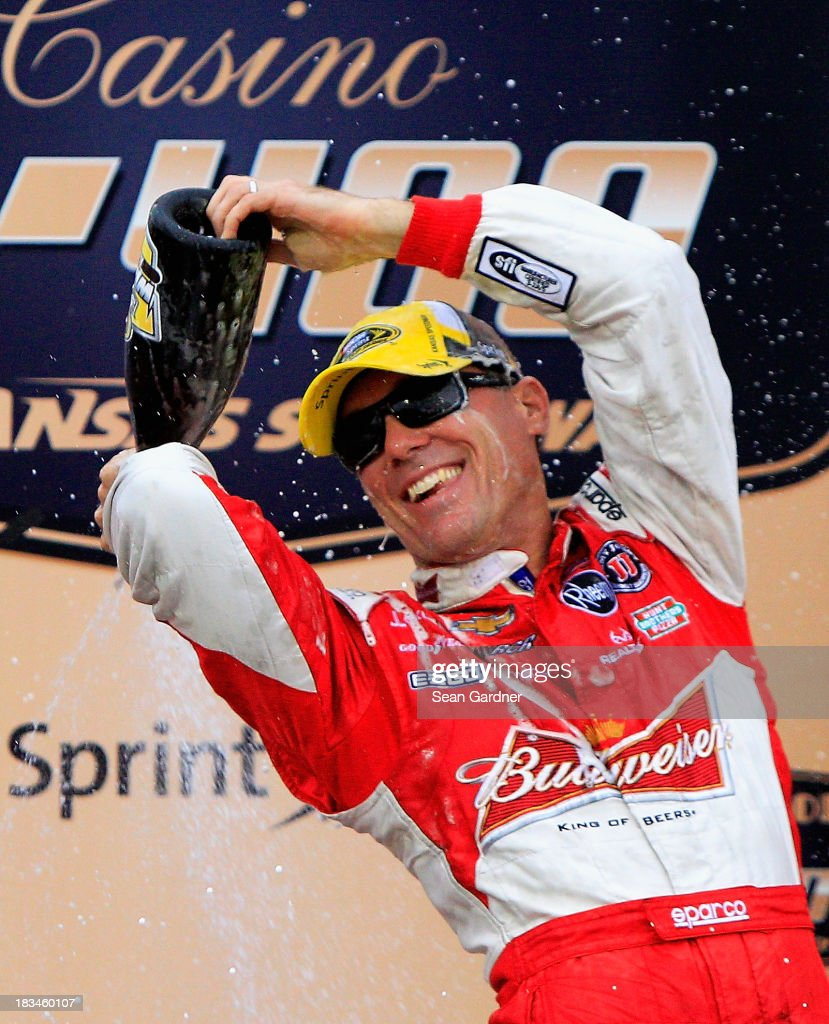 <a gi-track='captionPersonalityLinkClicked' href=/galleries/search?phrase=Kevin+Harvick&family=editorial&specificpeople=209186 ng-click='$event.stopPropagation()'>Kevin Harvick</a>, driver of the #29 Budweiser Chevrolet, celebrates in Victory Lane after winning the NASCAR Sprint Cup Series 13th Annual Hollywood Casino 400 at Kansas Speedway on October 6, 2013 in Kansas City, Kansas.