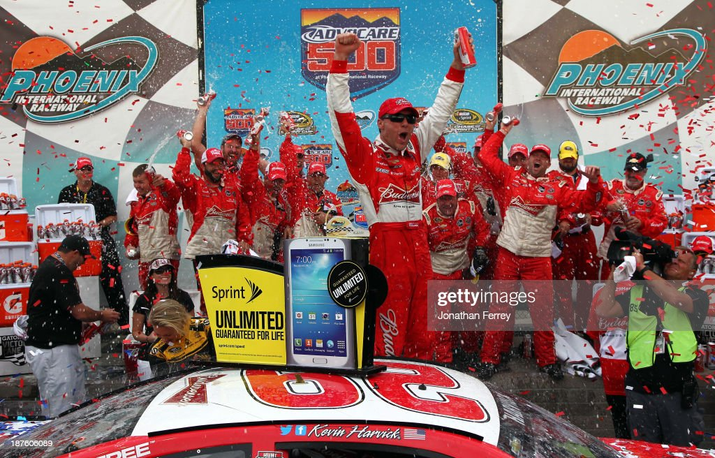<a gi-track='captionPersonalityLinkClicked' href=/galleries/search?phrase=Kevin+Harvick&family=editorial&specificpeople=209186 ng-click='$event.stopPropagation()'>Kevin Harvick</a>, driver of the #29 Budweiser Chevrolet, celebrates in victory lane after winning the NASCAR Sprint Cup Series AdvoCare 500 at Phoenix International Raceway on November 10, 2013 in Avondale, Arizona.