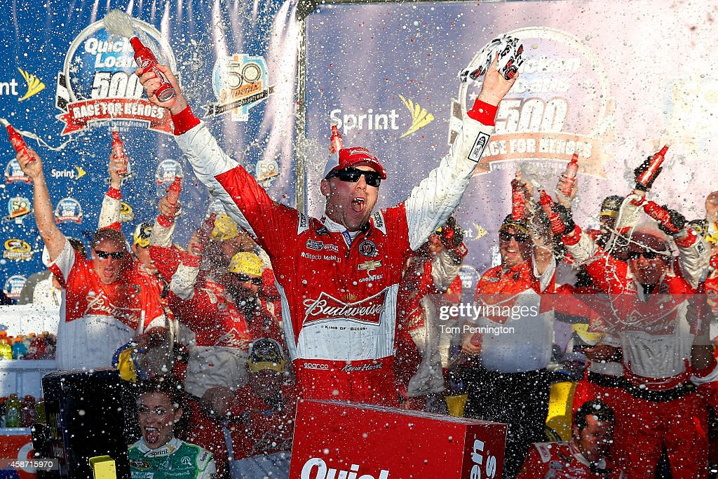 <a gi-track='captionPersonalityLinkClicked' href=/galleries/search?phrase=Kevin+Harvick&family=editorial&specificpeople=209186 ng-click='$event.stopPropagation()'>Kevin Harvick</a>, driver of the #4 Budweiser Chevrolet, celebrates in victory lane after winning the NASCAR Sprint Cup Series Quicken Loans Race for Heroes 500 at Phoenix International Raceway on November 9, 2014 in Avondale, Arizona.