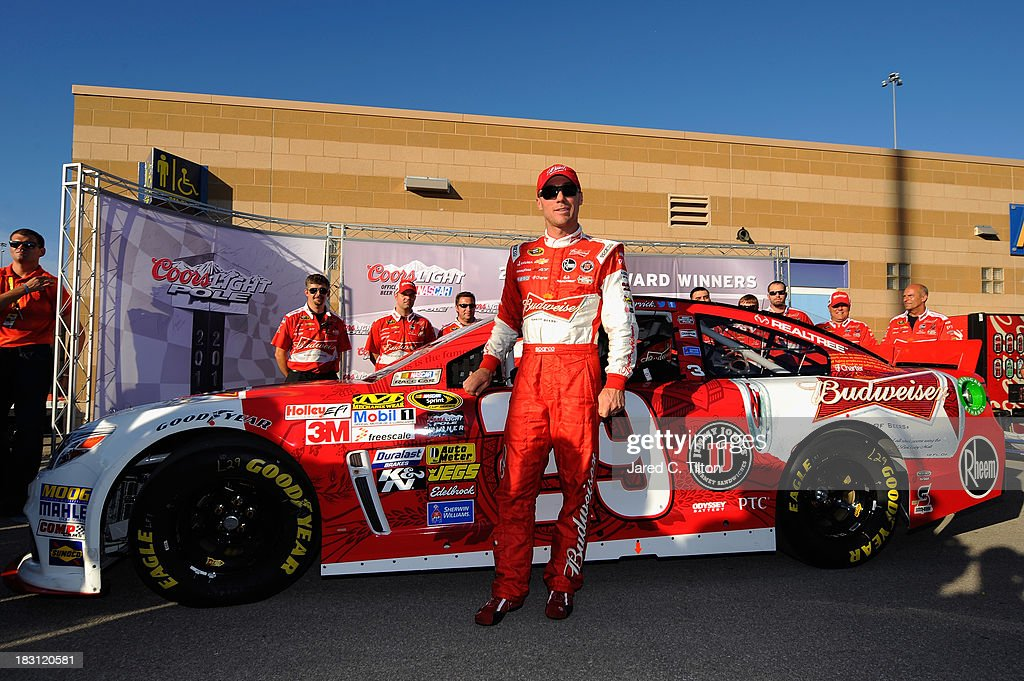 <a gi-track='captionPersonalityLinkClicked' href=/galleries/search?phrase=Kevin+Harvick&family=editorial&specificpeople=209186 ng-click='$event.stopPropagation()'>Kevin Harvick</a>, driver of the #29 Budweiser Chevrolet, celebrates qualifying for pole position for the NASCAR Sprint Cup Series 13th Annual Hollywood Casino 400 at Kansas Speedway on October 4, 2013 in Kansas City, Kansas.