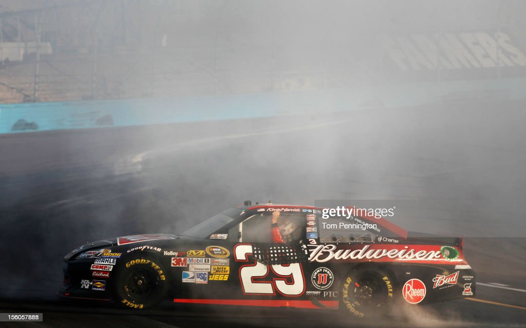 Kevin Harvick, driver of the #29 Budweiser Chevrolet, celebrates with a burnout after winning the NASCAR Sprint Cup Series AdvoCare 500 at Phoenix International Raceway on November 11, 2012 in Avondale, Arizona.