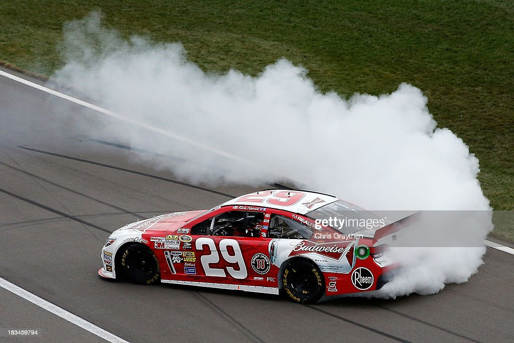 <a gi-track='captionPersonalityLinkClicked' href=/galleries/search?phrase=Kevin+Harvick&family=editorial&specificpeople=209186 ng-click='$event.stopPropagation()'>Kevin Harvick</a>, driver of the #29 Budweiser Chevrolet, celebrates with a burnout after winning the NASCAR Sprint Cup Series 13th Annual Hollywood Casino 400 at Kansas Speedway on October 6, 2013 in Kansas City, Kansas.