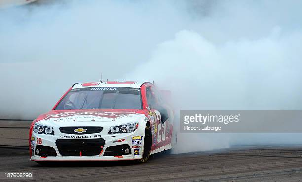 Kevin Harvick driver of the Budweiser Chevrolet celebrates with a burnout after winning the NASCAR Sprint Cup Series AdvoCare 500 at Phoenix...