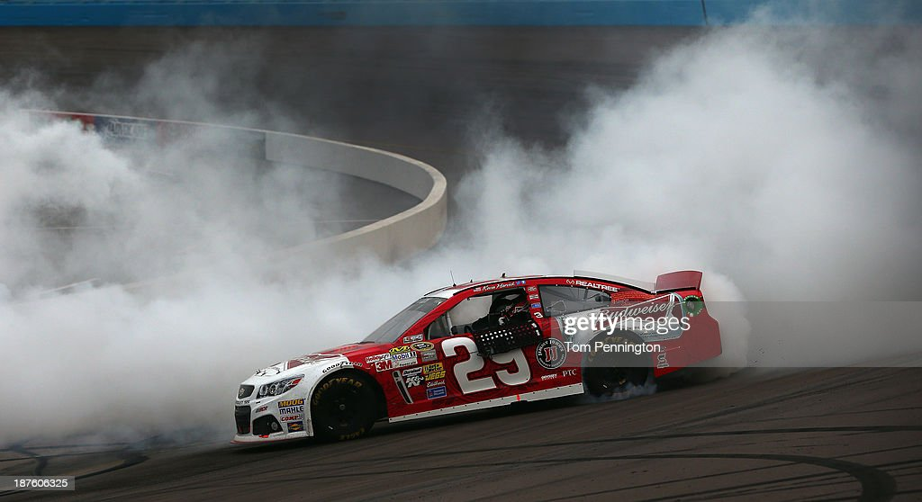 <a gi-track='captionPersonalityLinkClicked' href=/galleries/search?phrase=Kevin+Harvick&family=editorial&specificpeople=209186 ng-click='$event.stopPropagation()'>Kevin Harvick</a>, driver of the #29 Budweiser Chevrolet, celebrates with a burnout after winning the NASCAR Sprint Cup Series AdvoCare 500 at Phoenix International Raceway on November 10, 2013 in Avondale, Arizona.