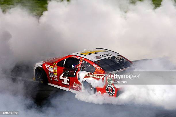Kevin Harvick driver of the Budweiser Chevrolet celebrates with a burnout after winnicelebrates with a burnout after winning the NASCAR Sprint Cup...