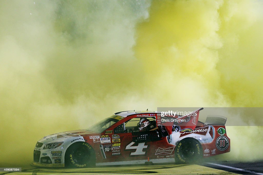 <a gi-track='captionPersonalityLinkClicked' href=/galleries/search?phrase=Kevin+Harvick&family=editorial&specificpeople=209186 ng-click='$event.stopPropagation()'>Kevin Harvick</a>, driver of the #4 Budweiser Chevrolet, celebrates with a burnout after winning the NASCAR Sprint Cup Series Ford EcoBoost 400 and the NASCAR Sprint Cup Series Championship at Homestead-Miami Speedway on November 16, 2014 in Homestead, Florida.