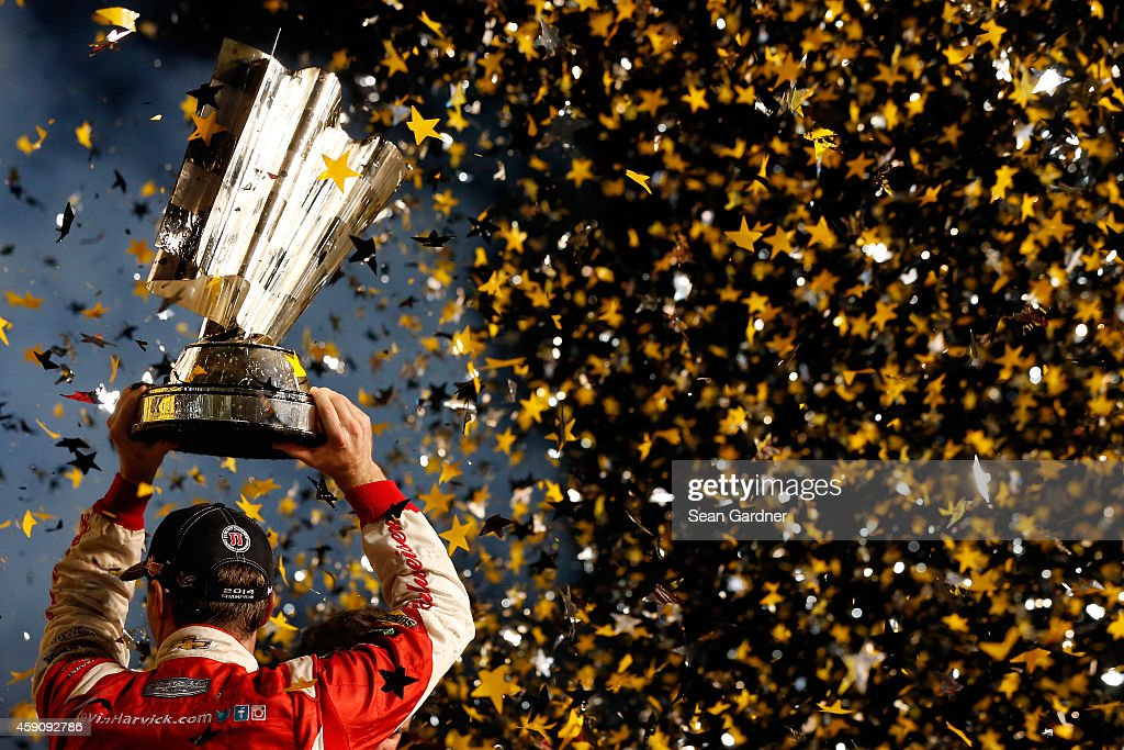 <a gi-track='captionPersonalityLinkClicked' href=/galleries/search?phrase=Kevin+Harvick&family=editorial&specificpeople=209186 ng-click='$event.stopPropagation()'>Kevin Harvick</a>, driver of the #4 Budweiser Chevrolet, celebrates with the trophy in victory lane after winning during the NASCAR Sprint Cup Series Ford EcoBoost 400 at Homestead-Miami Speedway on November 16, 2014 in Homestead, Florida.