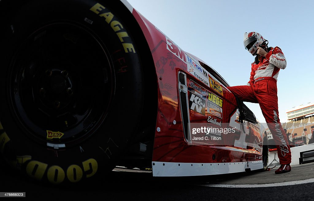 <a gi-track='captionPersonalityLinkClicked' href=/galleries/search?phrase=Kevin+Harvick&family=editorial&specificpeople=209186 ng-click='$event.stopPropagation()'>Kevin Harvick</a>, driver of the #4 Budweiser Chevrolet, climbs into his car during practice for the NASCAR Sprint Cup Series Food City 500 at Bristol Motor Speedway on March 15, 2014 in Bristol, Tennessee.