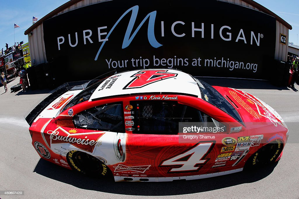 Kevin Harvick, driver of the #4 Budweiser Chevrolet, drives through the garage area during practice for the NASCAR Sprint Cup Series Quicken Loans 400 at Michigan International Speedway on June 14, 2014 in Brooklyn, Michigan.