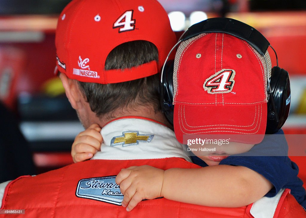 <a gi-track='captionPersonalityLinkClicked' href=/galleries/search?phrase=Kevin+Harvick&family=editorial&specificpeople=209186 ng-click='$event.stopPropagation()'>Kevin Harvick</a>, driver of the #4 Budweiser Chevrolet, holds his son Keelan in the garage area during practice for the NASCAR Sprint Cup Series FedEx 400 Benefiting Autism Speaks at Dover International Speedway on May 31, 2014 in Dover, Delaware.