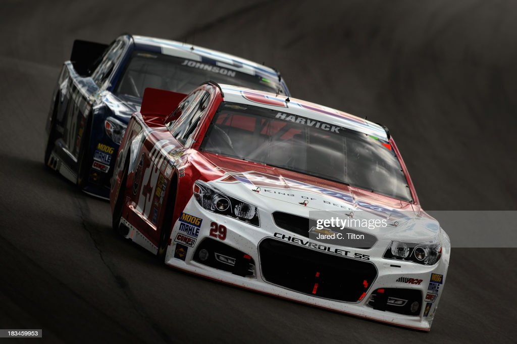 Kevin Harvick, driver of the #29 Budweiser Chevrolet, leads Jimmie Johnson, driver of the #48 Lowe's Chevrolet, during the NASCAR Sprint Cup Series 13th Annual Hollywood Casino 400 at Kansas Speedway on October 6, 2013 in Kansas City, Kansas.