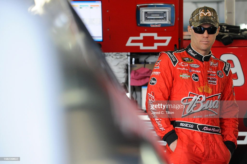 Kevin Harvick, driver of the #29 Budweiser Chevrolet, looks on during testing at Charlotte Motor Speedway on December 11, 2012 in Concord, North Carolina.