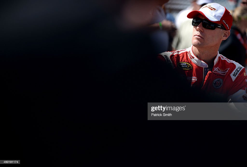 <a gi-track='captionPersonalityLinkClicked' href=/galleries/search?phrase=Kevin+Harvick&family=editorial&specificpeople=209186 ng-click='$event.stopPropagation()'>Kevin Harvick</a>, driver of the #4 Budweiser Chevrolet, looks on from the grid during qualifying for the NASCAR Sprint Cup Series Pocono 400 at Pocono Raceway on June 6, 2014 in Long Pond, Pennsylvania.