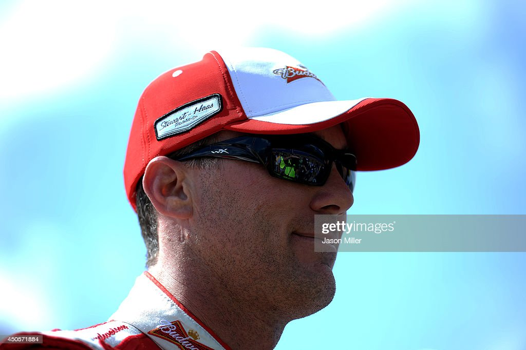 <a gi-track='captionPersonalityLinkClicked' href=/galleries/search?phrase=Kevin+Harvick&family=editorial&specificpeople=209186 ng-click='$event.stopPropagation()'>Kevin Harvick</a>, driver of the #4 Budweiser Chevrolet, looks on from the grid during qualifying for the NASCAR Sprint Cup Series Quicken Loans 400 at Michigan International Speedway on June 13, 2014 in Brooklyn, Michigan.
