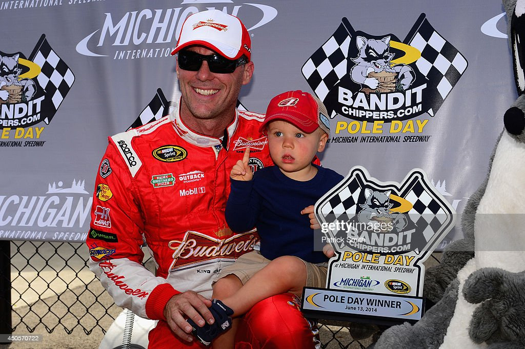<a gi-track='captionPersonalityLinkClicked' href=/galleries/search?phrase=Kevin+Harvick&family=editorial&specificpeople=209186 ng-click='$event.stopPropagation()'>Kevin Harvick</a>, driver of the #4 Budweiser Chevrolet, poses with son Keelan and the BanditChippers.com Pole Award after qualifying for the pole for the NASCAR Sprint Cup Series Quicken Loans 400 at Michigan International Speedway on June 13, 2014 in Brooklyn, Michigan.