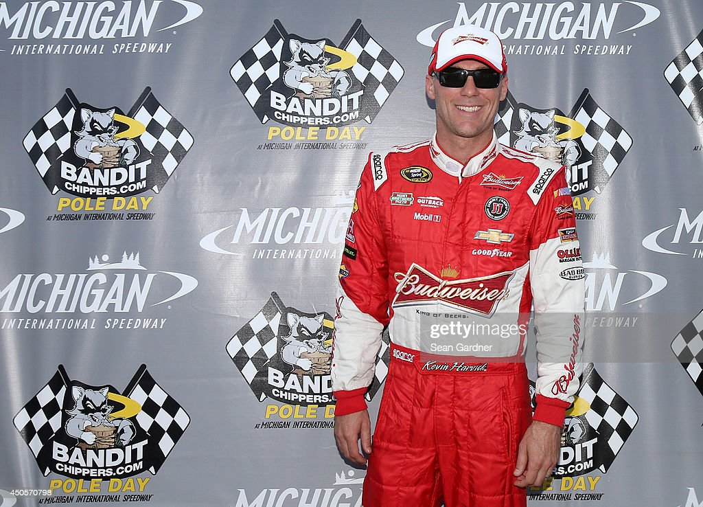 <a gi-track='captionPersonalityLinkClicked' href=/galleries/search?phrase=Kevin+Harvick&family=editorial&specificpeople=209186 ng-click='$event.stopPropagation()'>Kevin Harvick</a>, driver of the #4 Budweiser Chevrolet, poses with the BanditChippers.com Pole Award after qualifying for the pole for the NASCAR Sprint Cup Series Quicken Loans 400 at Michigan International Speedway on June 13, 2014 in Brooklyn, Michigan.