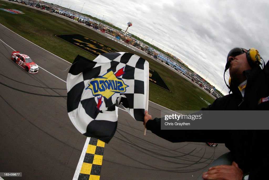 Kevin Harvick, driver of the #29 Budweiser Chevrolet, races to the checkered flag to win the NASCAR Sprint Cup Series 13th Annual Hollywood Casino 400 at Kansas Speedway on October 6, 2013 in Kansas City, Kansas.