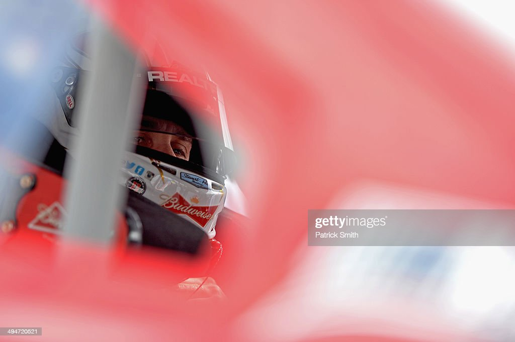 Kevin Harvick, driver of the #4 Budweiser Chevrolet, sits in his car during qualifying for the NASCAR Sprint Cup Series FedEx 400 Benefiting Autism Speaks at Dover International Speedway on May 30, 2014 in Dover, Delaware.