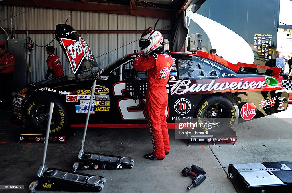 <a gi-track='captionPersonalityLinkClicked' href=/galleries/search?phrase=Kevin+Harvick&family=editorial&specificpeople=209186 ng-click='$event.stopPropagation()'>Kevin Harvick</a>, driver of the #29 Budweiser Chevrolet, stands by his car during practice for the NASCAR Sprint Cup Series Federated Auto Parts 400 at Richmond International Raceway on September 7, 2012 in Richmond, Virginia.
