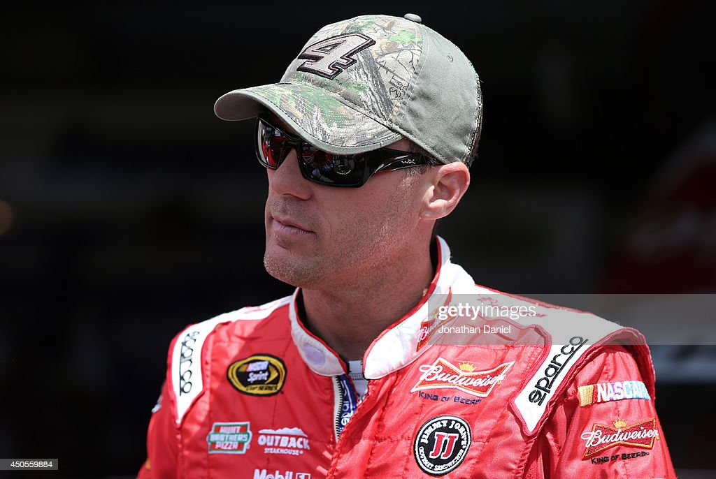 <a gi-track='captionPersonalityLinkClicked' href=/galleries/search?phrase=Kevin+Harvick&family=editorial&specificpeople=209186 ng-click='$event.stopPropagation()'>Kevin Harvick</a>, driver of the #4 Budweiser Chevrolet, stands in the garage area during practice for the NASCAR Sprint Cup Series Quicken Loans 400 at Michigan International Speedway on June 13, 2014 in Brooklyn, Michigan.
